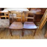 A pair of Victorian mahogany hollow seat dining chairs