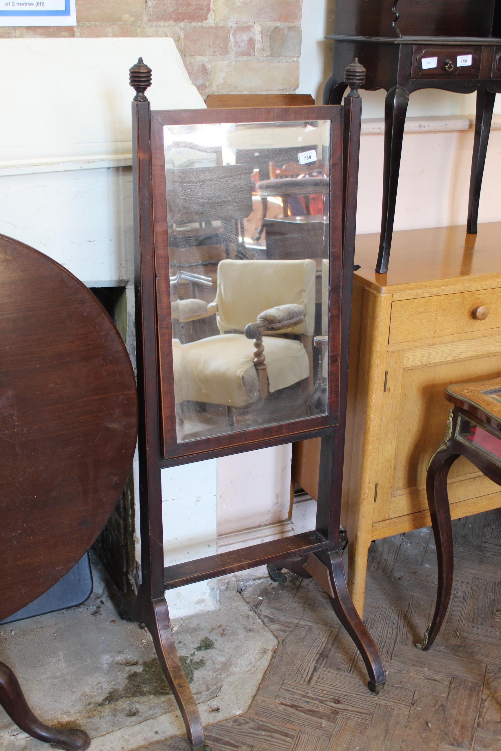 A Regency mahogany cheval mirror with bevelled glass (repair to leg)