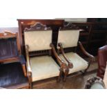 A pair of late 19th Century French walnut upholstered armchairs