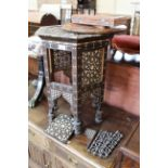 A Moorish style hexagonal inlaid and shaped low table (as found)