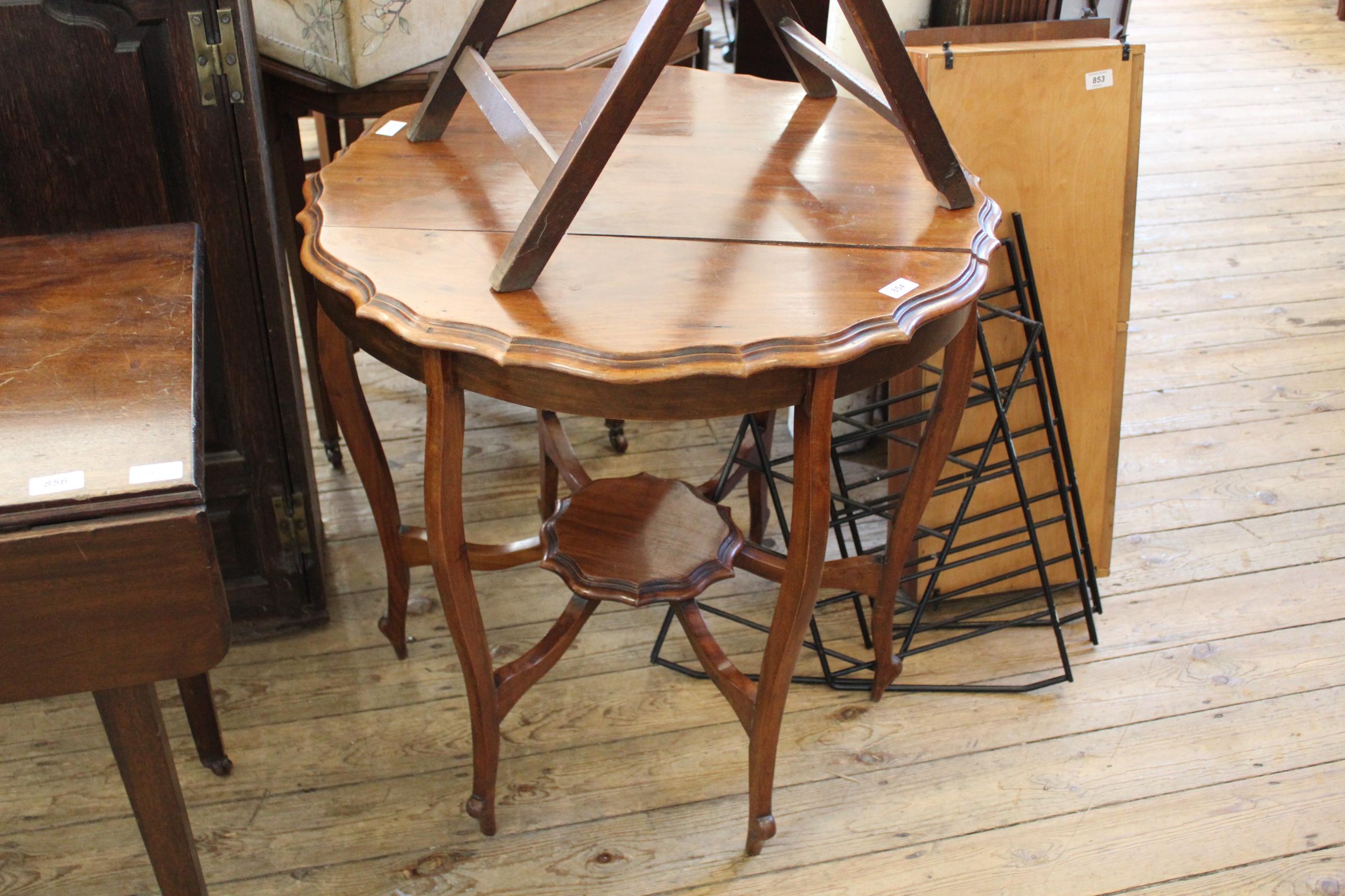 An Edwardian spider leg pie crust table
