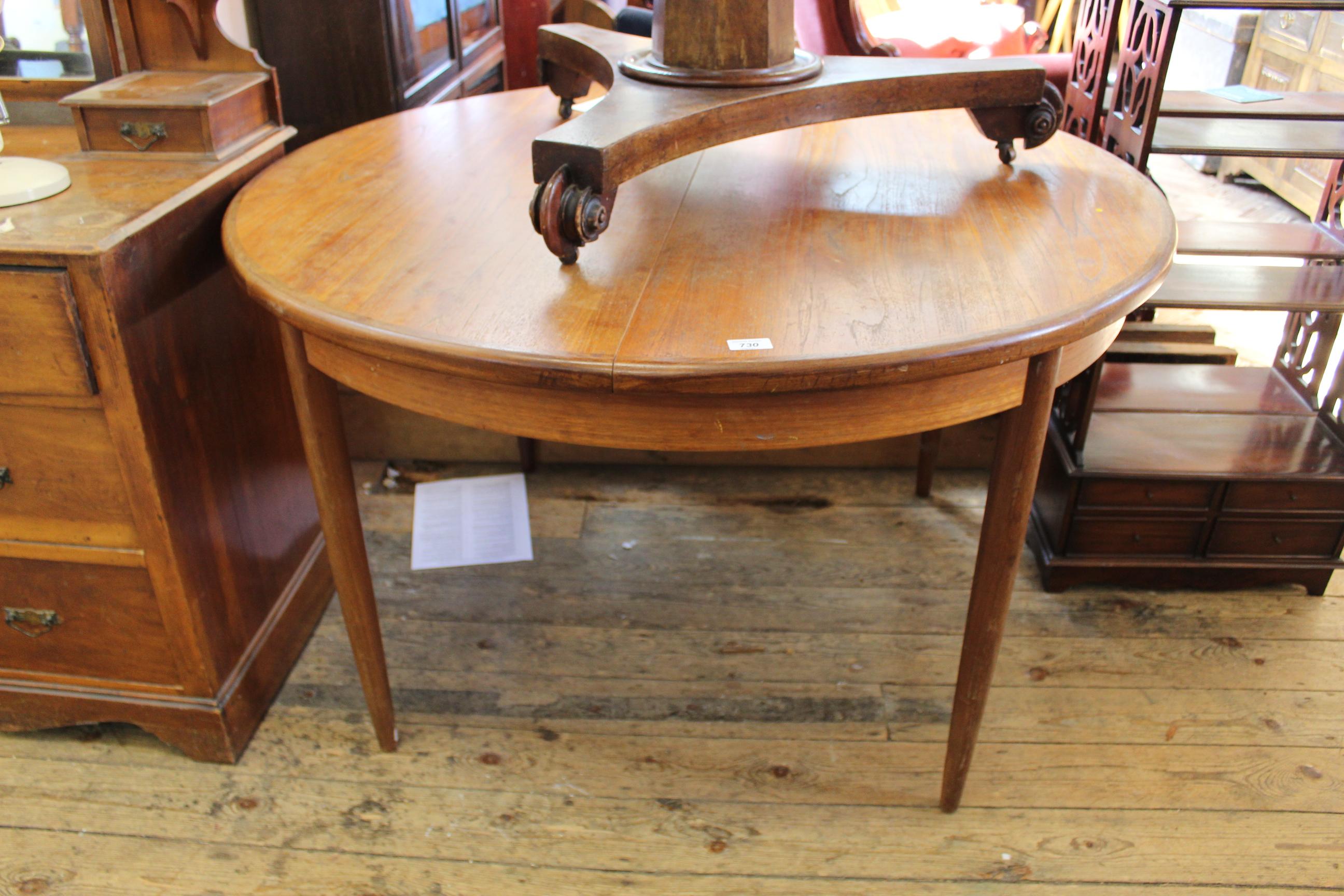 A mid Century G Plan circular dining table