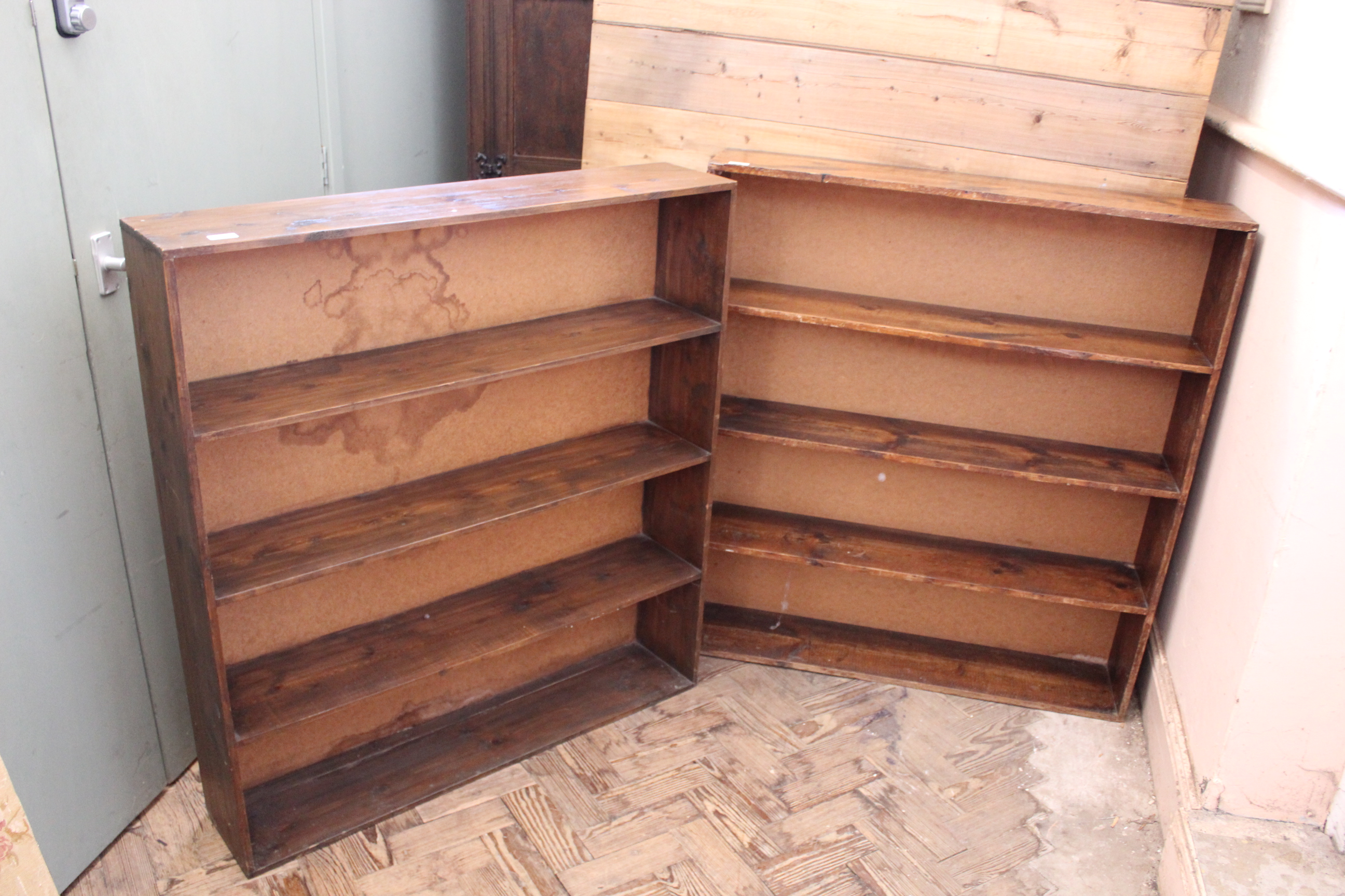 A pair of stained pine bookshelves