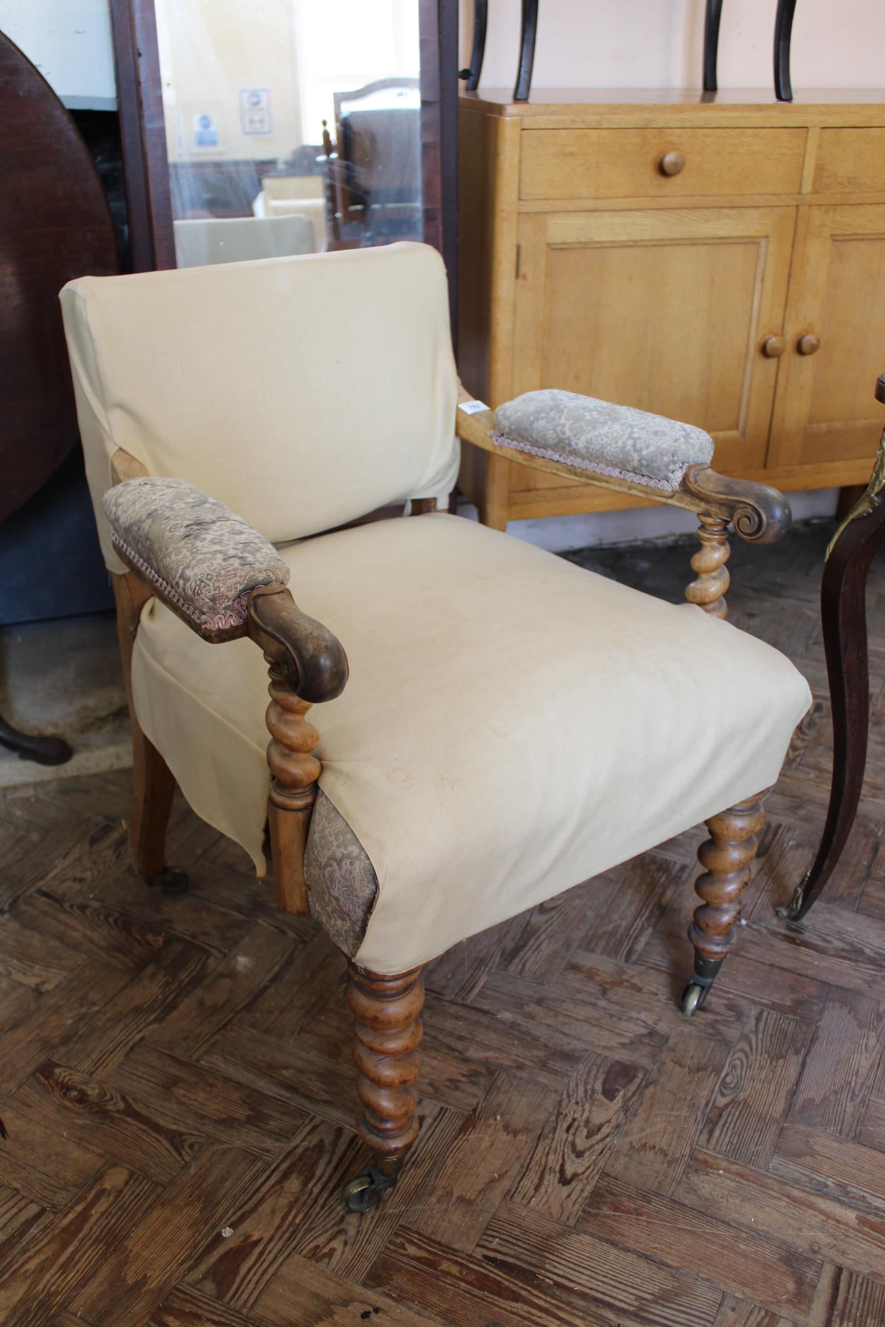 A William IV upholstered mahogany armchair