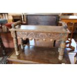 A late Victorian carved oak window seat