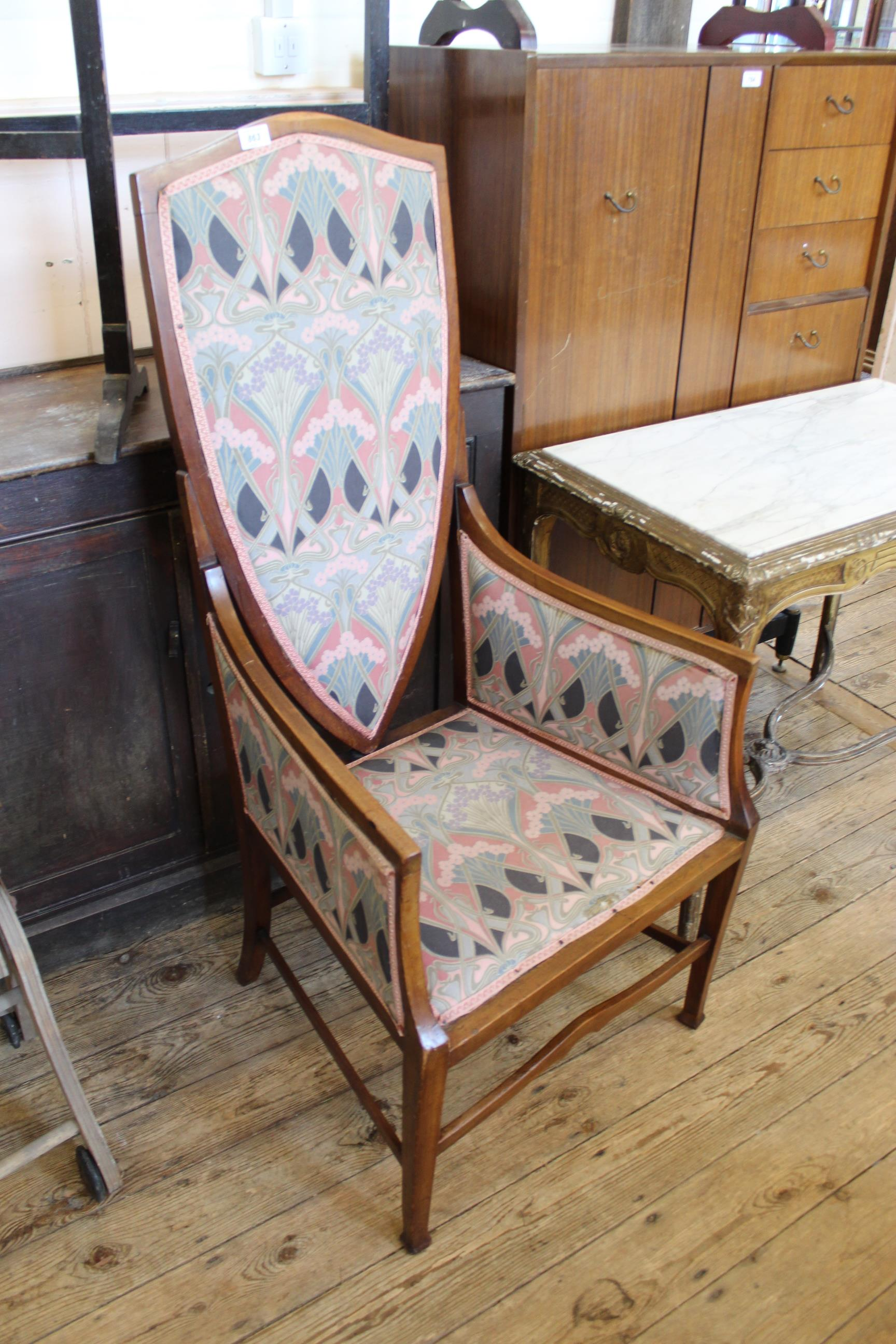 An Edwardian mahogany chair with high shield shaped back,