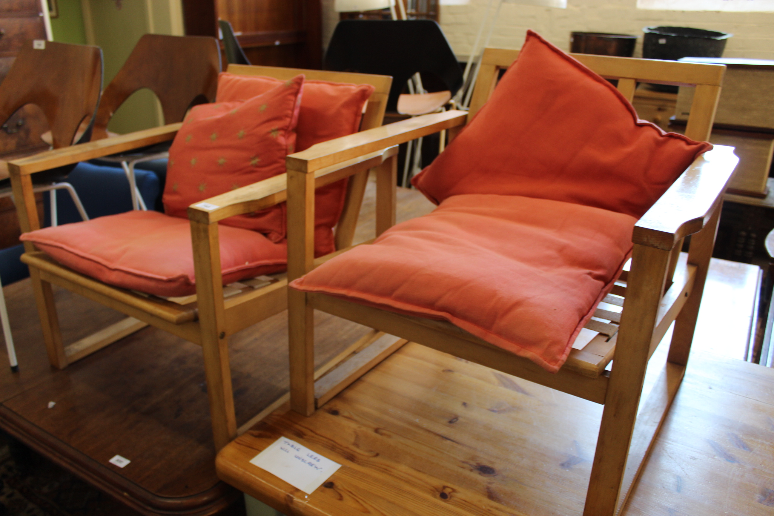 A pair of 1960's beech armchairs with loose cushions