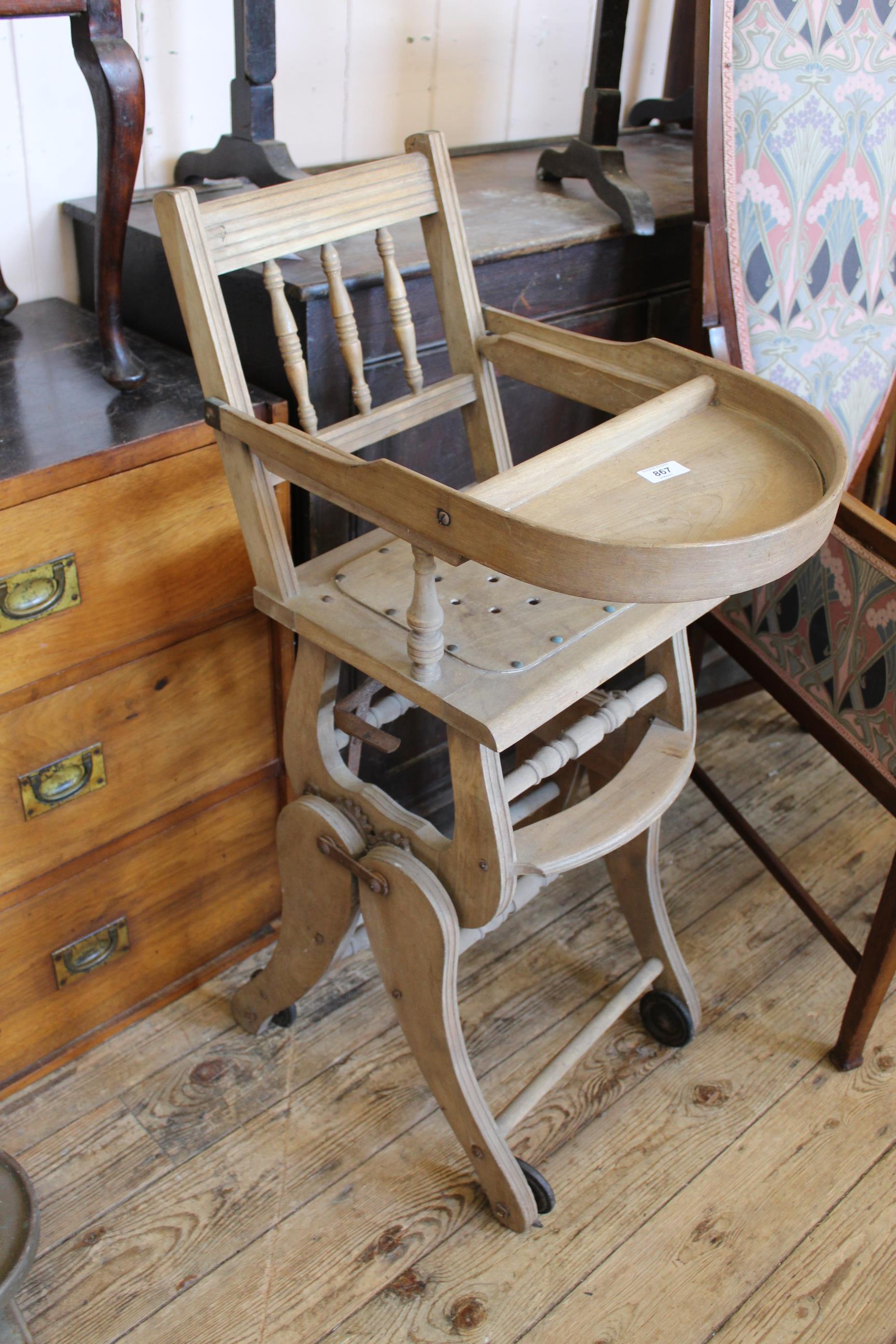 An Edwardian beech child's folding high chair