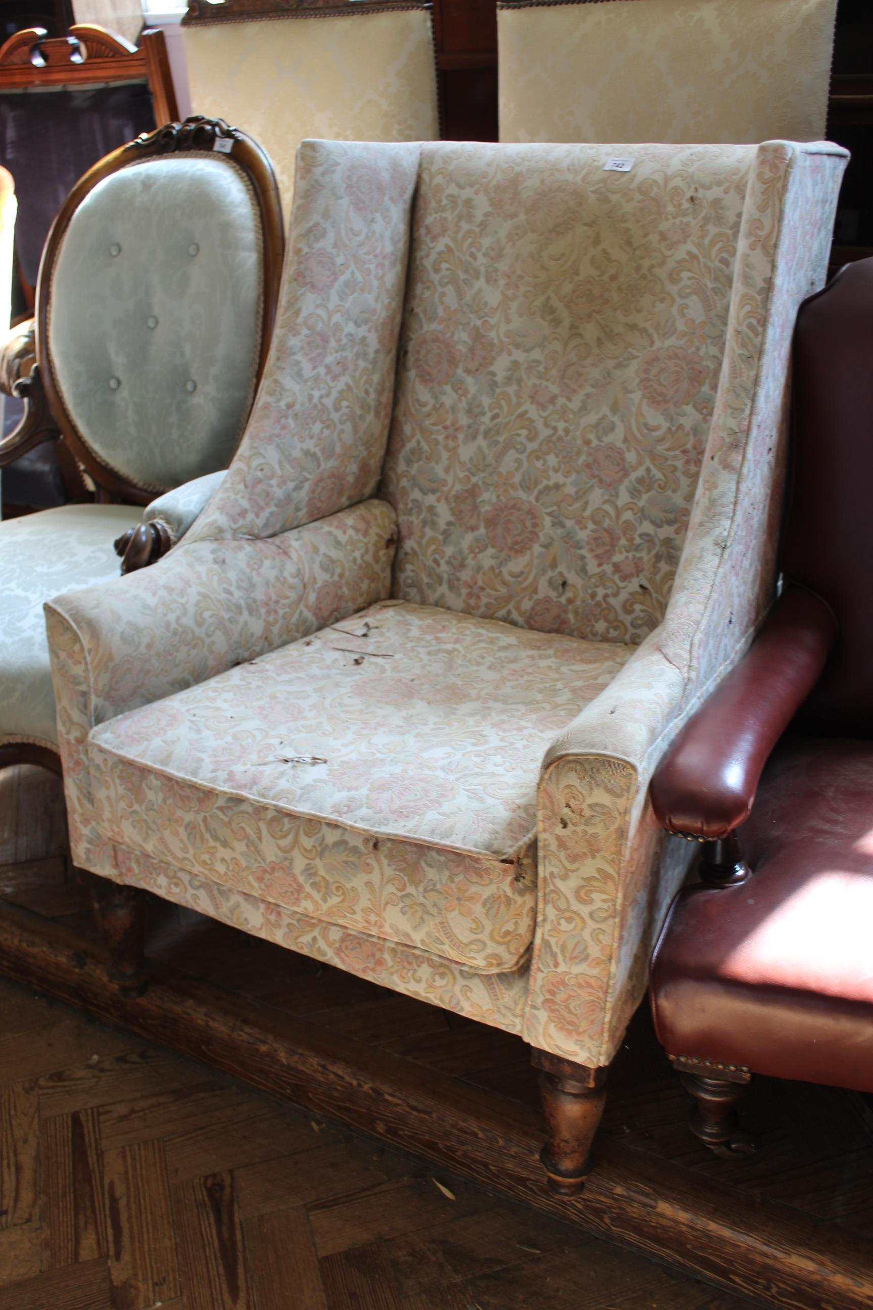 A late Victorian upholstered wing armchair