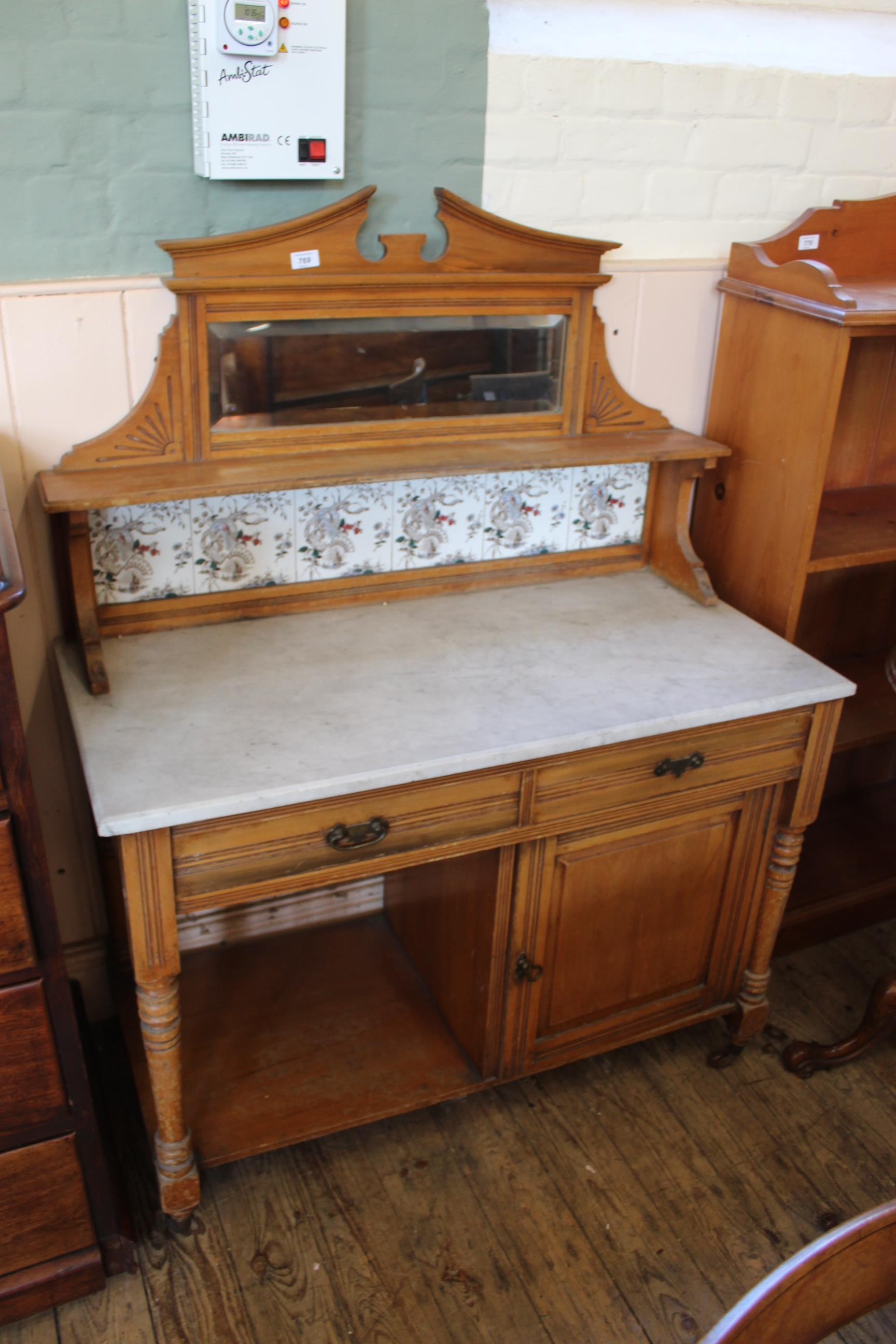A late Victorian satin birch marble top washstand with tile back