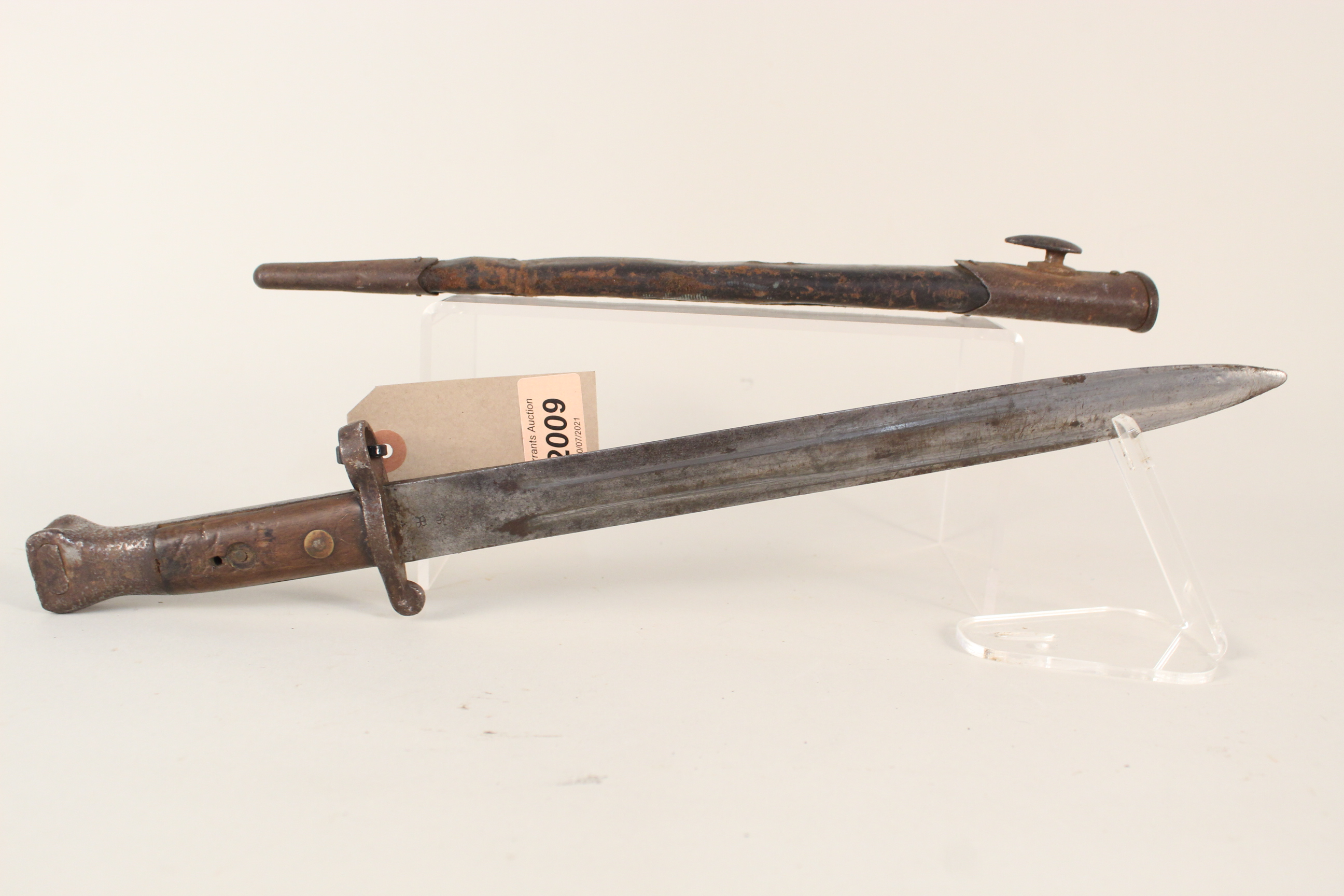 A British 1888 model bayonet (Mk I 2nd type) by Mole with scabbard (in overall worn condition)