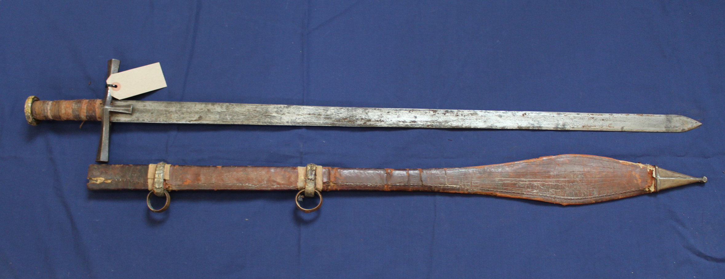An ethnic sword with leather tooled scabbard - Image 3 of 3