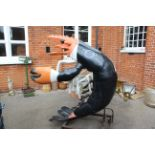 A large fibre glass lobster on metal stand, shop advertisement in the form or a novelty waiter,