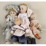 A large selection of porcelain headed collectors dolls