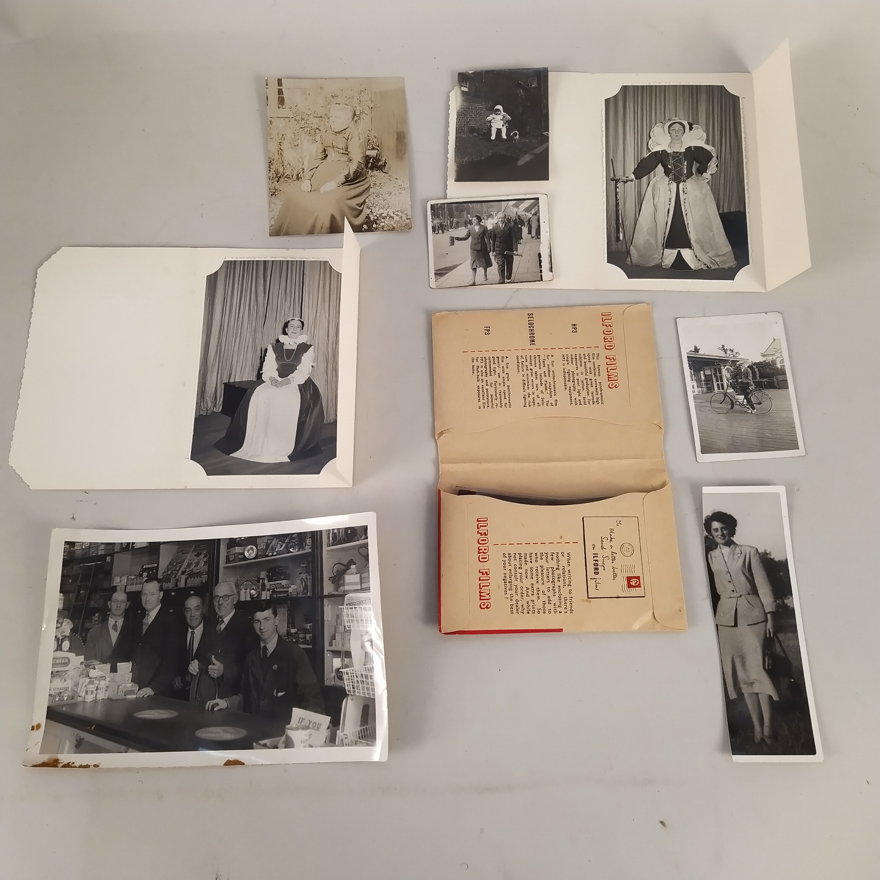A selection of vintage postcards plus a box of early photographs