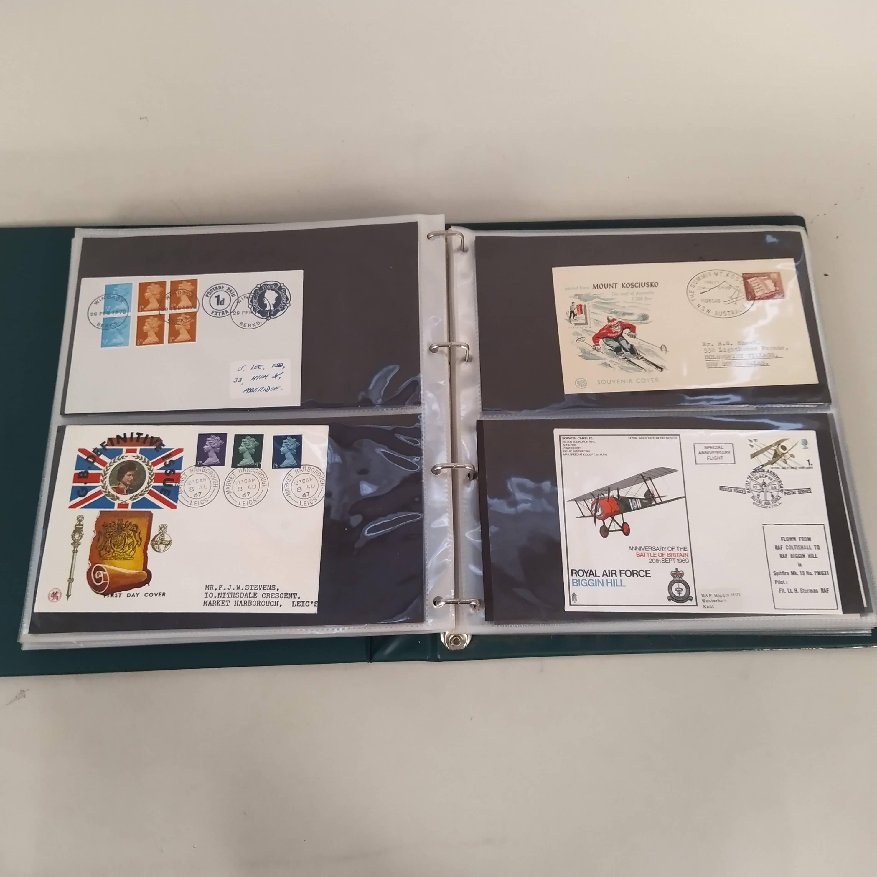 A part filled first day cover album plus three various stamp albums,