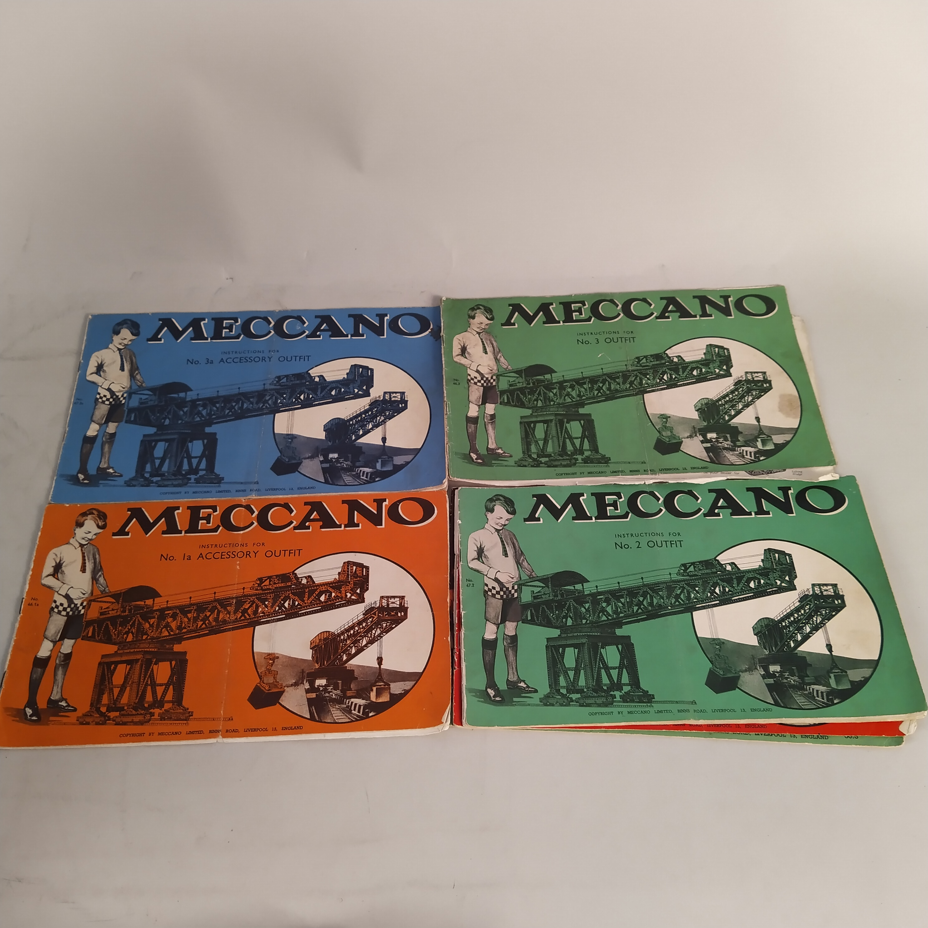 A large collection of cased and boxed Meccano accessories including booklets on construction