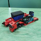 A mixed lot of Corgi 1:50 scale low loaders with loads,