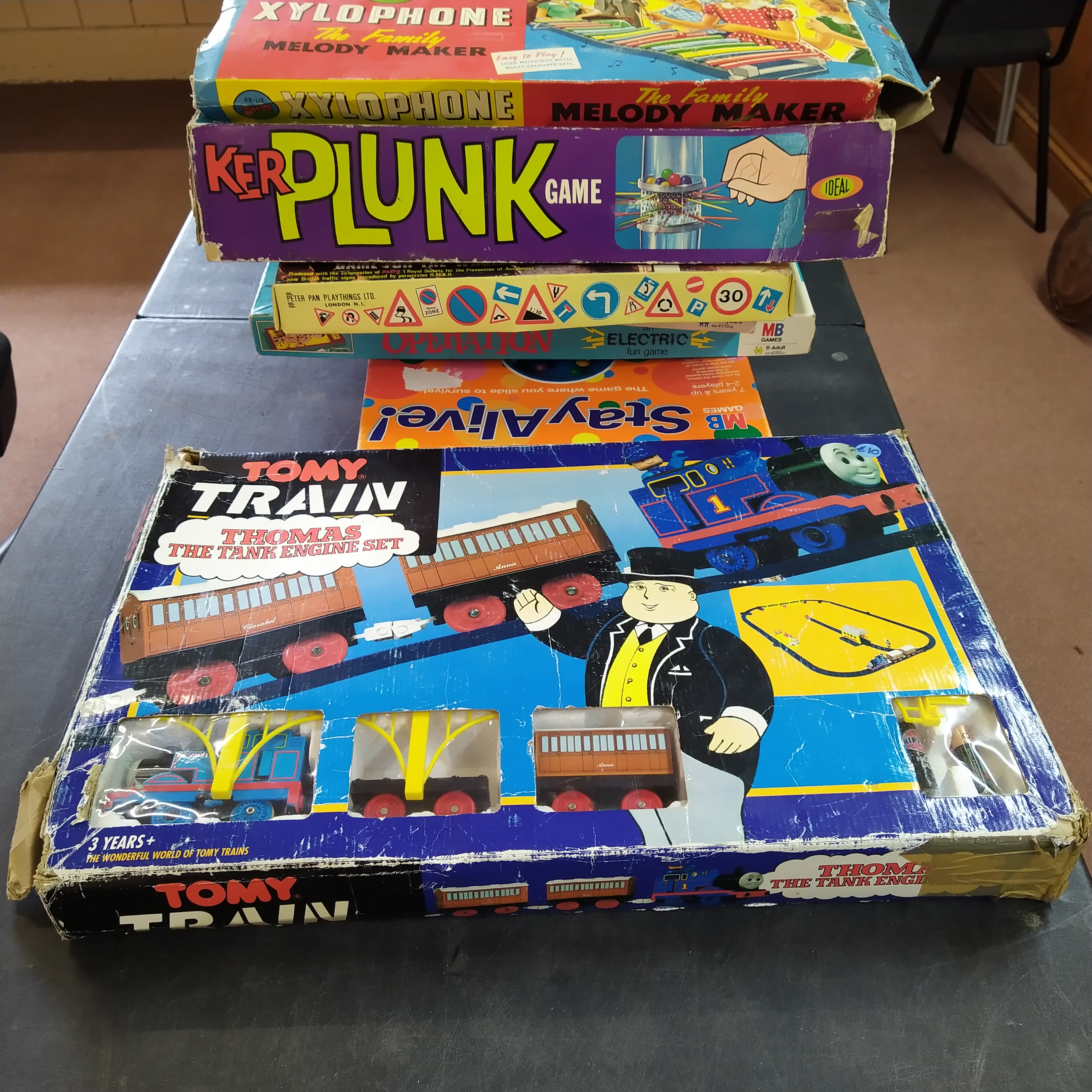 A large quantity of board games including Marx Clear Round and Thomas the Tank Engine set