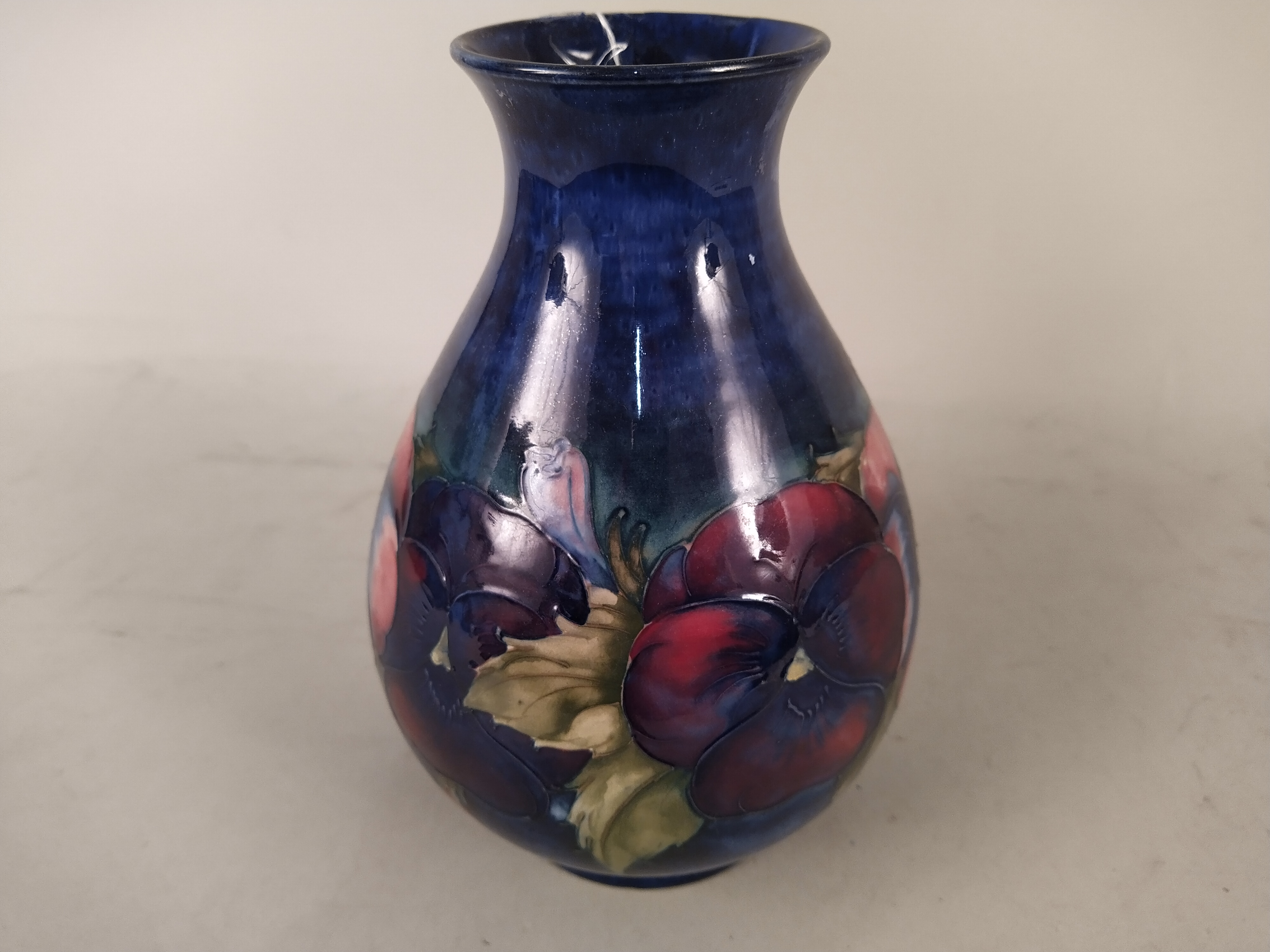 A Moorcroft Pansy pattern vase, bears blue signature and potter to H.M. - Image 3 of 3