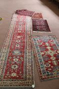 """A group of mixed floor rugs including a runner 10 1/2"""" x 33"""","""