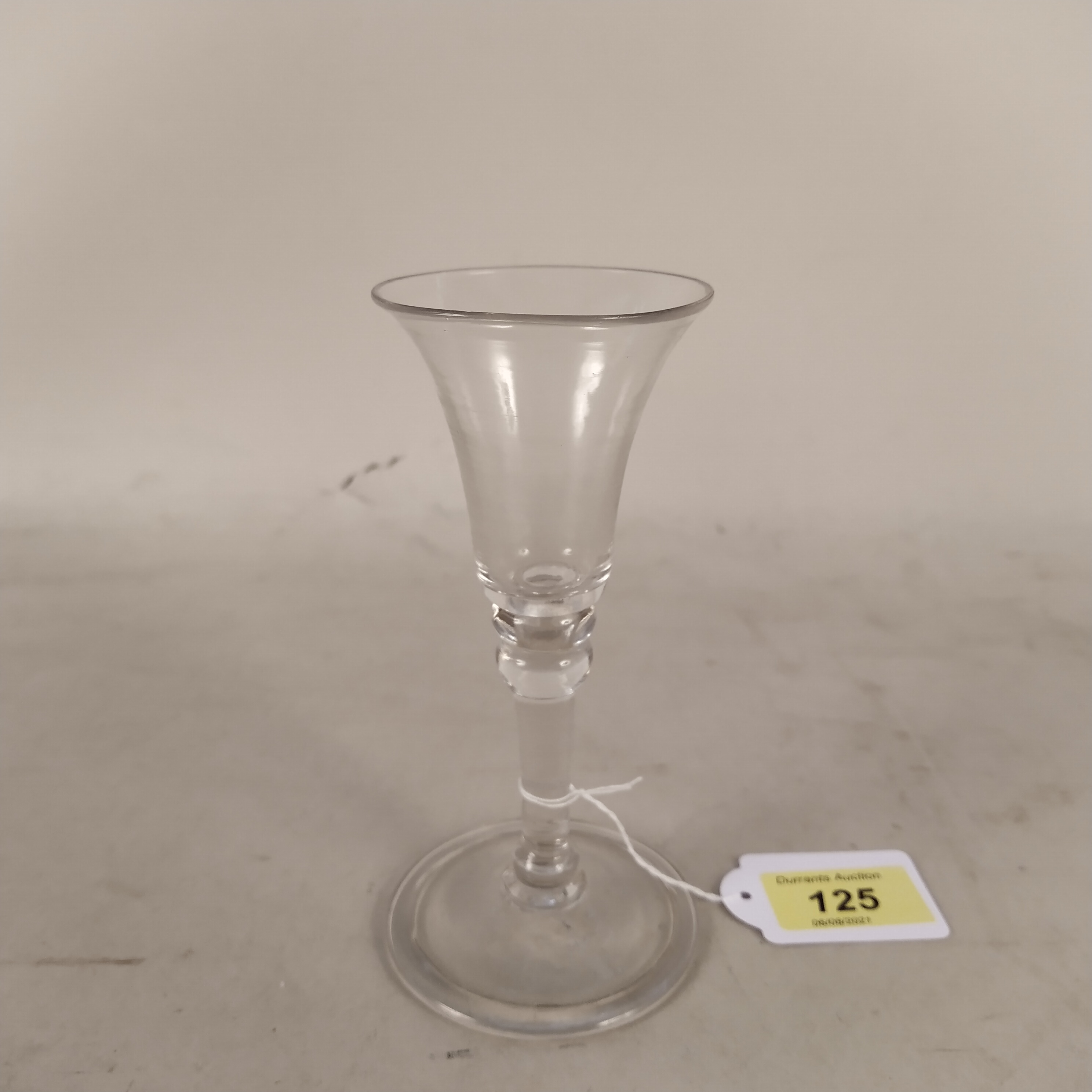 An English wine glass c1750 with bell shaped bowl,
