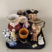 A selection of Toby and character jugs including Queen Victoria, Sylvac,