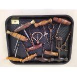 Approx thirteen assorted antique corkscrews