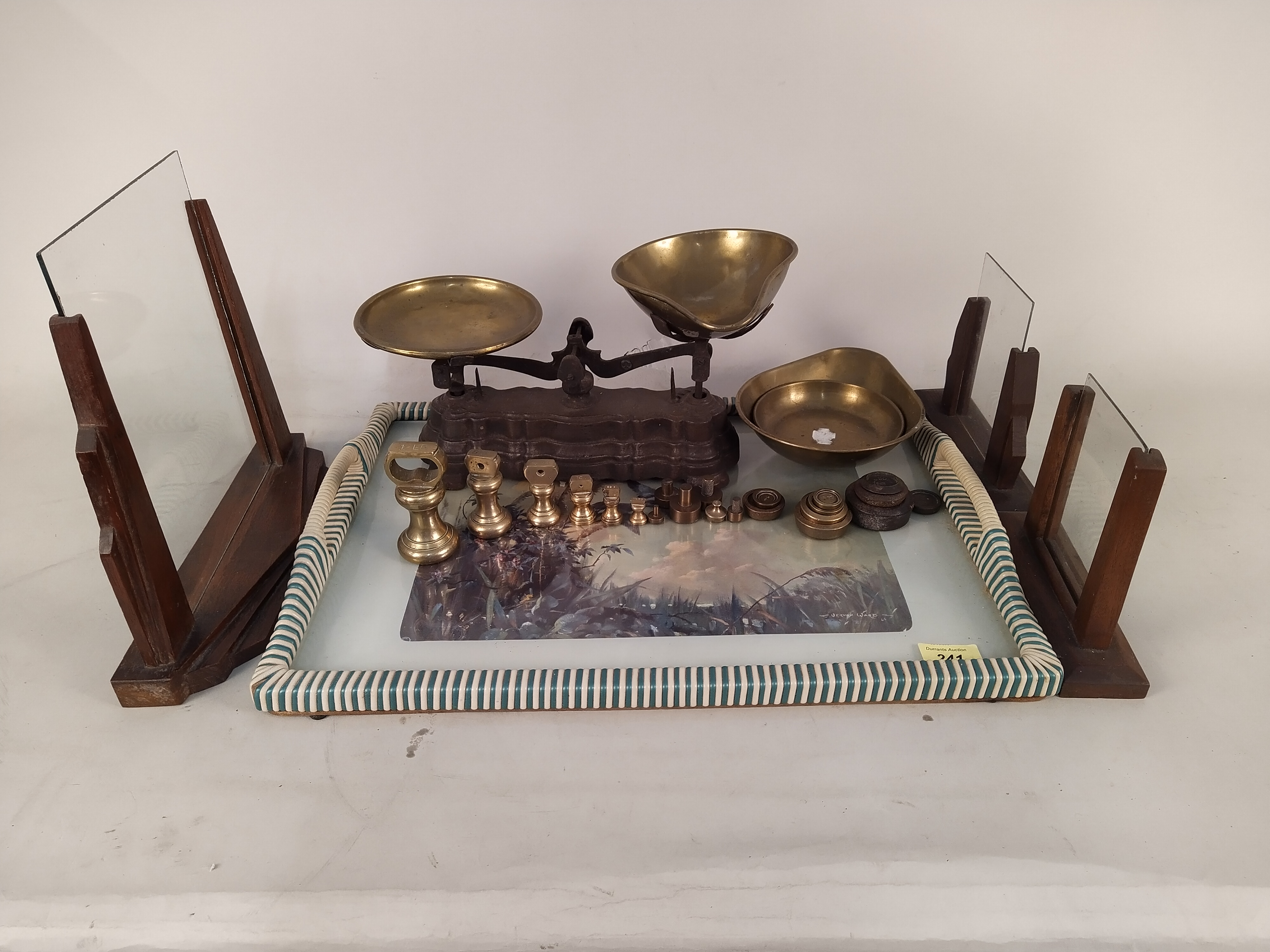 A 1960's tea tray, a set of 1920's kitchen scales with spare pans,