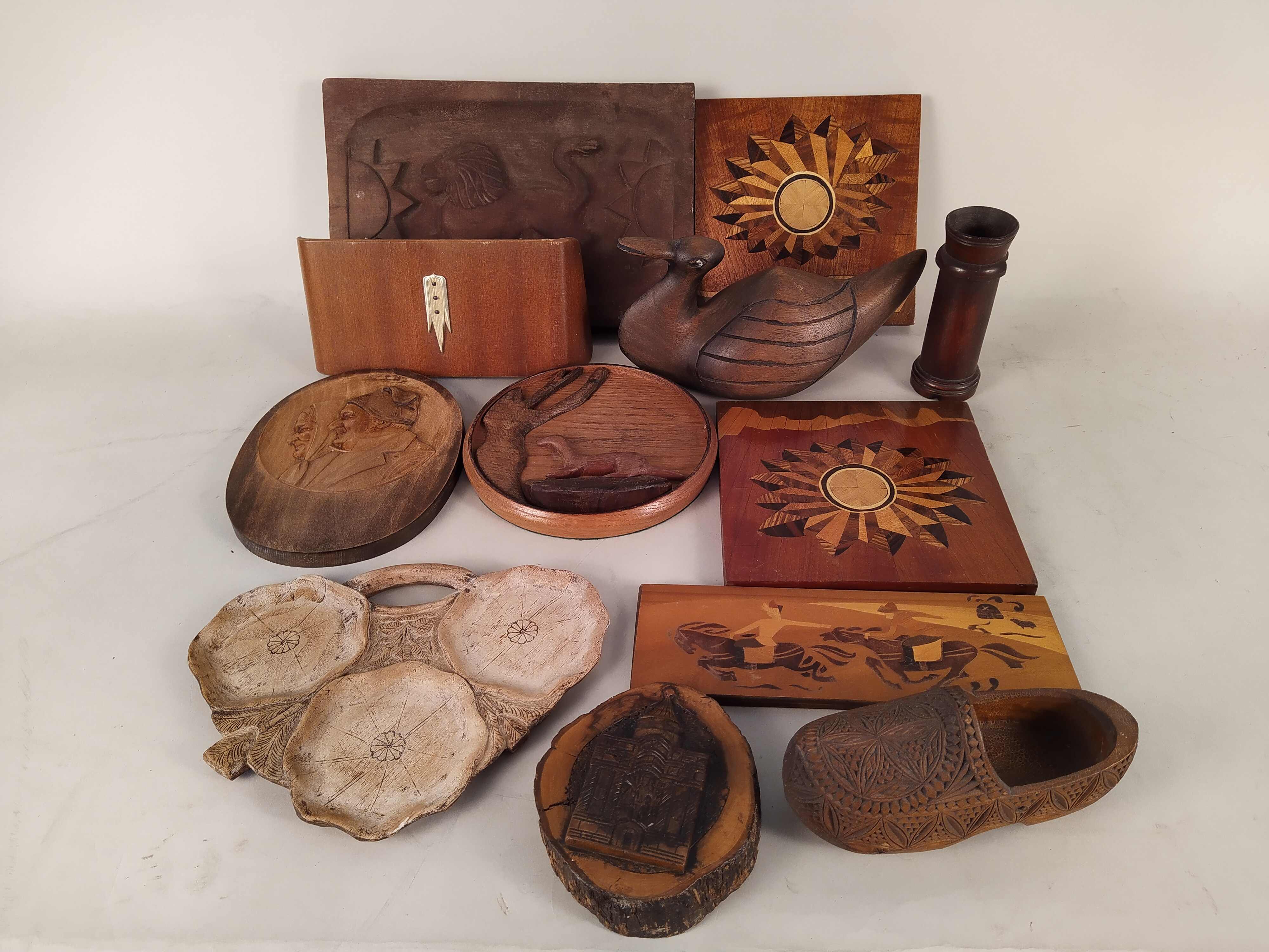A selection of inlaid and carved wood wares plus two small metal animal door wedges
