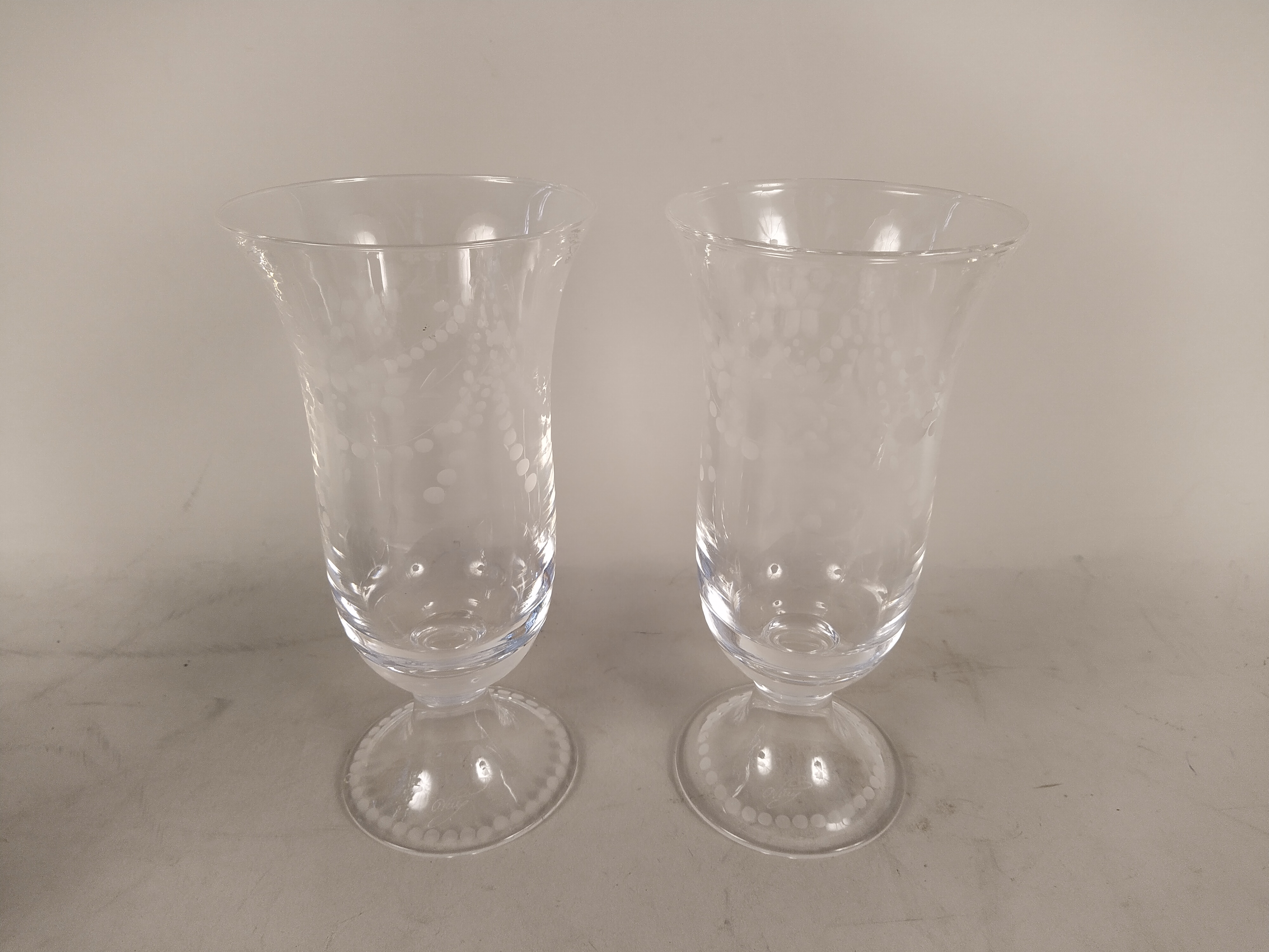 A pair of hand blown and cut green decanters (some chips to neck and an old repair to stoppers) - Image 2 of 3