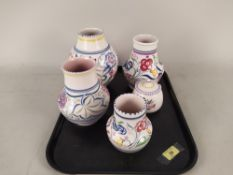 Five pieces of Poole pottery,