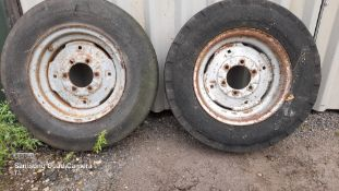 Pair of 750 x 16 front wheels. Stored near Eye, Suffolk.