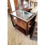 A vintage mahogany frame hostess trolley with glass top