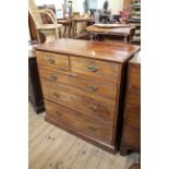 An Edwardian mahogany five drawer chest