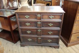 A George II oak five drawer chest with applied mouldings and original escutcheons