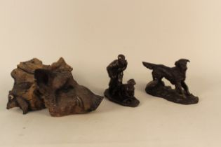 An interesting cast resin boars head resembling carved wood,