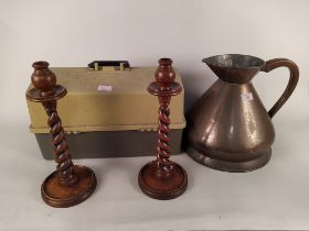 """A pair of 1920's oak barley twist candlesticks, a copper jug stamped """"2 gallons V.R."""