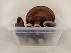 A box of miscellaneous items including a wooden lazy Susan, two pairs of large ornamental clogs,