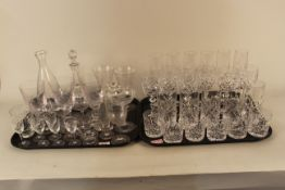 A large quantity of assorted glassware including cut glass hock and wine glasses,