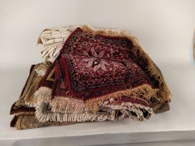 A collection of five small hearth rugs and two hessian table cloths