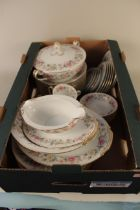 A Noritake china part dinner service including a tureen with four cups and saucers