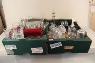 Two boxes of mixed glassware including drinking glasses from various airlines