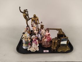 A selection of nine German porcelain figures, three brass mirrors, a brass model blacksmith,