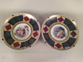 A pair of late 19th Century Schierholz porcelain dishes heavily gilded with central hand painted