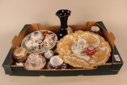 A box containing a large heavily gilded dish with crossed sword mark, a selection of Limoges items,