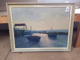 A framed oil on board of boats in a bay,