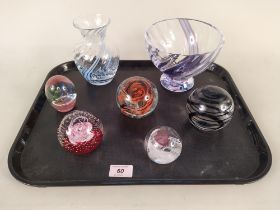 Five assorted glass paperweights including two Caithness examples,