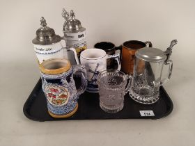 A pair of German porcelain steins commemorating Christmas 2000 and 2001,