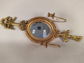 An ornate French style gilded mirror with candle holders,